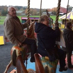 Enjoying the galloping horses at Beamish Fairground