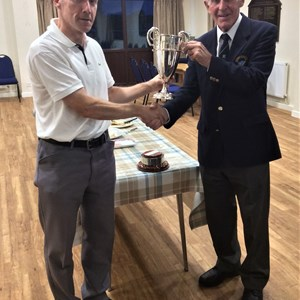 Hovingham League Captain Ed Charge receives the Winner's Trophy 2019