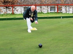 President, Richard North, bowls the first wood of 2016 season