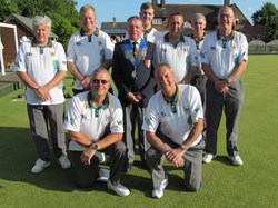 Whittlesey Manor - 2017 Munday Shield winners with Peterborough League president Bruce Saint.