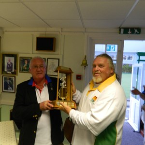 President Bob Peckings presenting Kev Clarke with the Farley Trophy