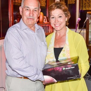 Mrs Pow presents club member Edward Broom with a set of Drakes Pride bowls which Edward won in a raffle.