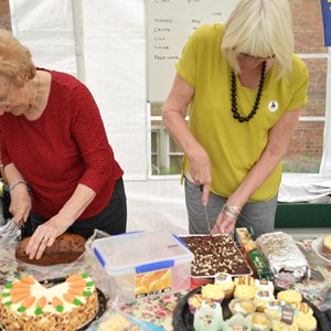 Carnival 2016; Ladies from Inner Wheel serving cakes from their stall.       Courtesy of Hertford Online