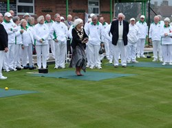 Avril Kerswell, Mayor of Bovey Tracey, preparing to bowl the first bowl of the season.