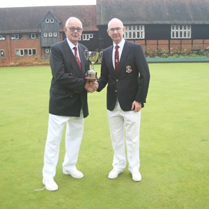 Three woods: President Reg Turner presenting the cup to David Willoughby