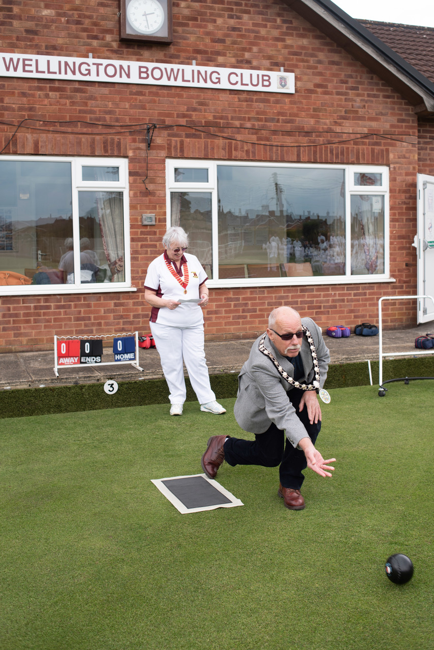 Wellington town mayor, Cllr Gary James, bowls the first wood of the 2019 season