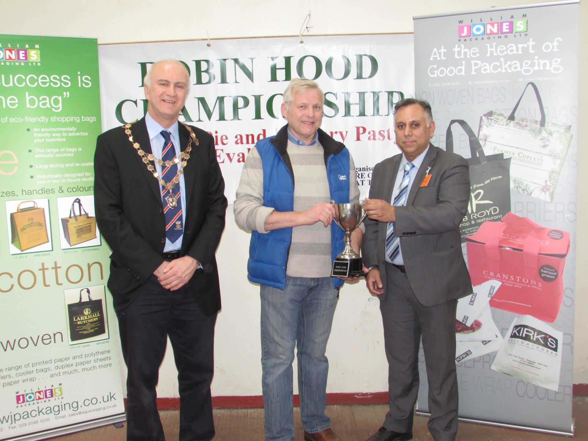 Notts Council Trophy being presented to Michael Kennedy, Holywell, Flintshire by Sat Lola with President of the Nottinghamshire Council of Retail Meat Traders, Neil Curtis.