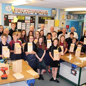 Helping RWB Academy student learn practical skills with bird box making