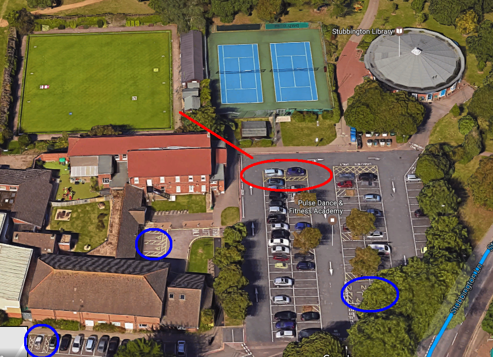 Mobility-accessible parking spaces, marked red closest to Bowling Green; others marked blue