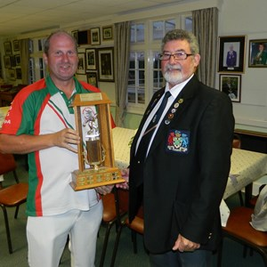 Chris Fenner presents Steve Thompson of North Down with the Farley Trophy