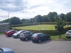 Veiw of green and car park