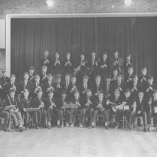 This photograph shows the John Hunt School Orchestra with Norman Pickering, about the year 1960.