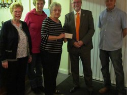 A £760 cheque presented to Magpas Air Ambulance by Margaret Bavister along with Rita Mace, Sue Welsford and Martin Welsford.