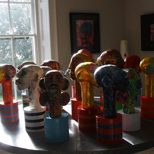 Lizzie Thurman's papier mache Heads in the Morning Room