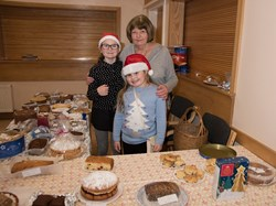 Eileen and Grand Daughters at the cake stall