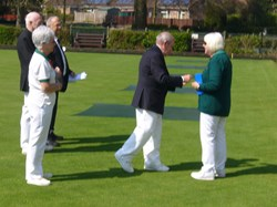 Ladies Captain Janet collects her badge