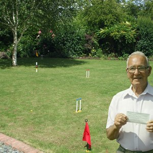 Steve with the cheque from the John Ross Foundation, which was used to purchase the Croquet equipment