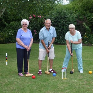 Marie, Steve and Sandie try out the new Croquet Lawn