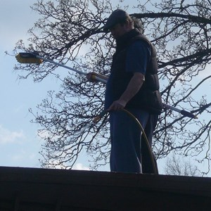 Bryan and Roly cleaning the veranda roof