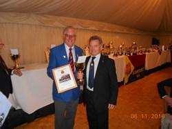 Vice Captain Mike Rawle receiving our East 1 Division Winners Trophy from Bill Smith, Bowls England JVC at the County Lunch