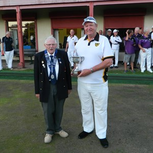 Brian Snell presents the Plympton Captain Ray Atrill with the cup.