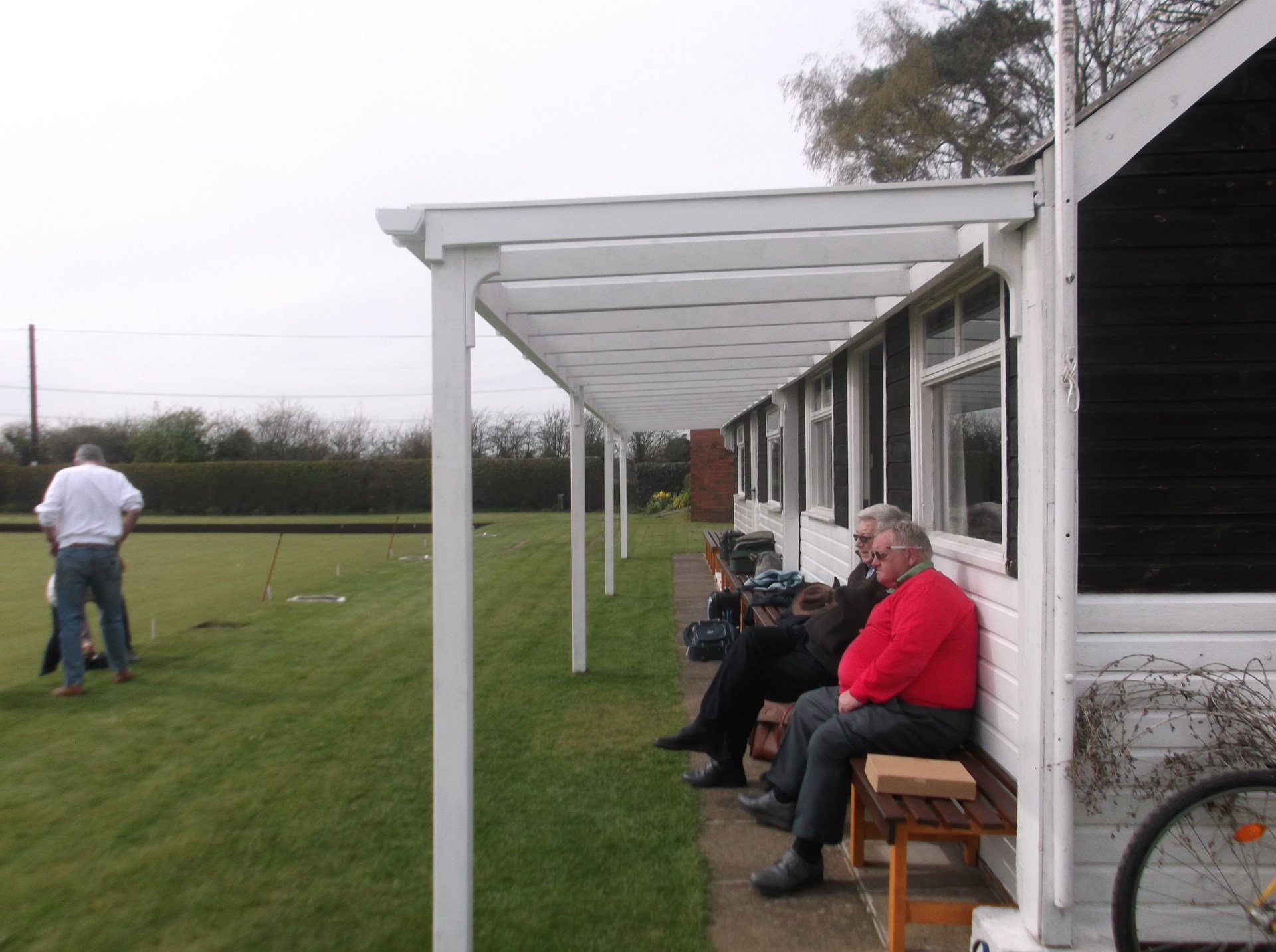 Members enjoying awning