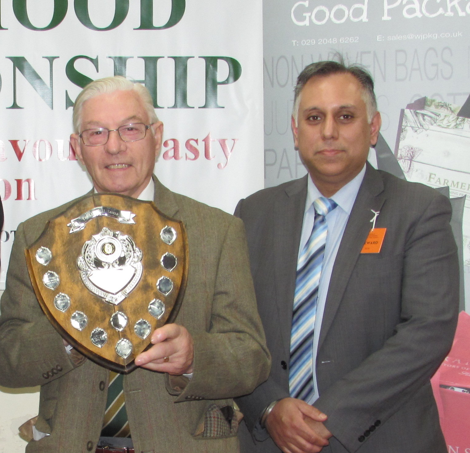 Allan Bennett of Codsall, Wolverhampton receiving the Council Shield from Sat Lola of  William Jones Packaging Ltd who supported the Robin Hood Championship.